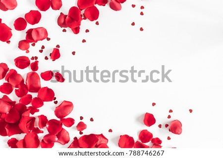 Valentine's Day. Flowers composition. Round frame made of rose flowers, confetti on white background. Valentines day background. Flat lay, top view, copy space.