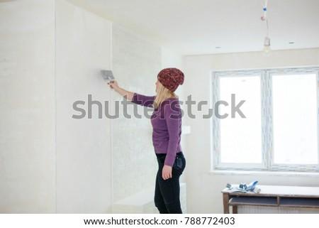 Girl girl doing repairs in room #788772403