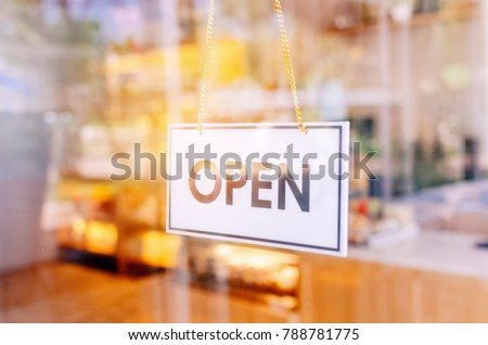 Open sign broad through the glass of door in cafe. Business service and food concept. Vintage tone filter color style. #788781775