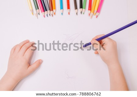 Little boy drawing greeting card on table. Father's day concept