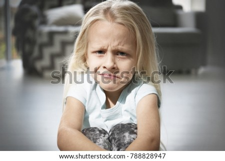Helpless little girl crying indoors. Child abuse concept #788828947