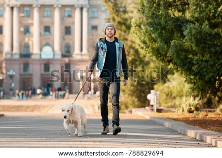 Handsome young hipster with dog outdoors #788829694