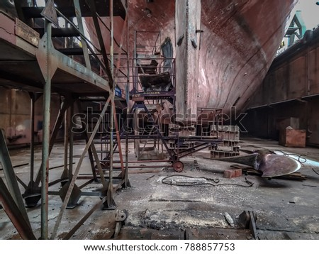Vessel in the dock. Shipyard inside. #788857753