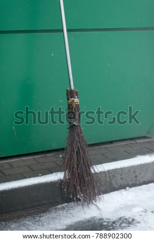 broom from rods at the green wall. #788902300