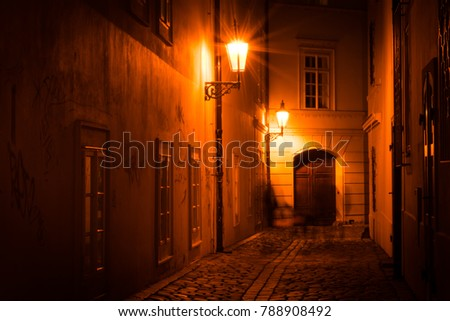 Mysterious narrow back street with lanterns in Prague at night #788908492