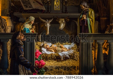 Christmas Nativity scene with The Holy Child, The Blessed Virgin Mary, Saint Joseph, ox and donkey #788942026