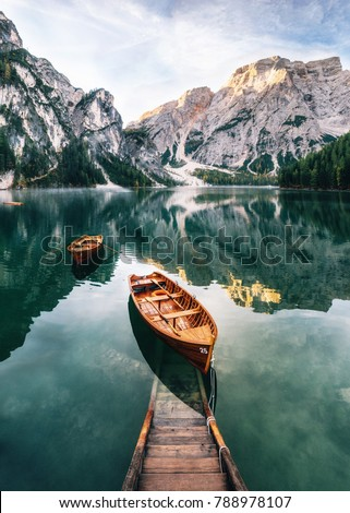 Boats and slip construction in Braies lake with crystal water in background of Seekofel mountain in Dolomites in morning, Italy Pragser Wildsee #788978107