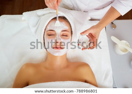 Woman in mask on face in spa salon. #788986801