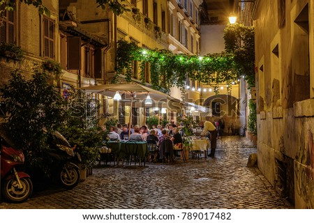 Night view of old cozy street in Trastevere in Rome, Italy.  Trastevere is rione of Rome, on the west bank of the Tiber in Rome, Lazio, Italy.  Architecture and landmark of Rome #789017482