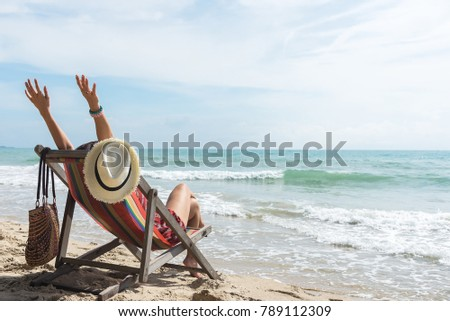 happy woman with open arms enjoying the summer sea vacation .Summer holiday concept #789112309