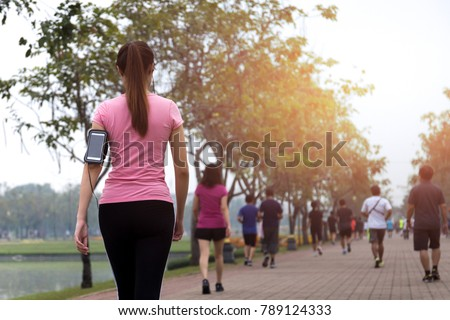 Group of people exercise walking in the park in morning #789124333