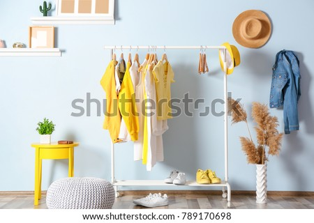 Collection of clothes hanging on rack in dressing room #789170698