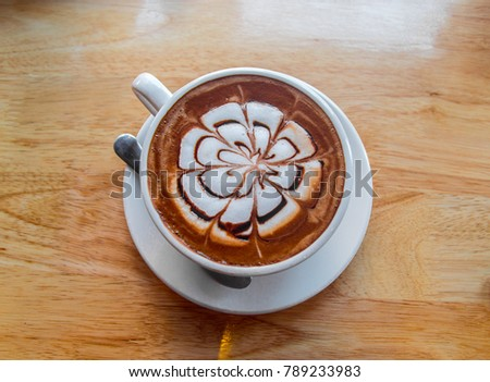 hot coffee mocha latte on wooden table background #789233983