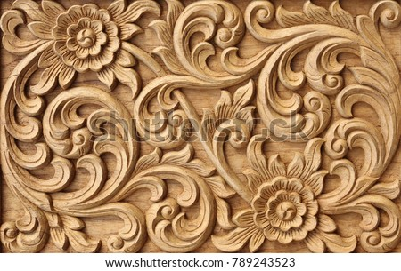 Pattern of flower carved on wood background. #789243523