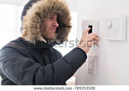 Man With Warm Clothing Feeling The Cold Inside House #789353500