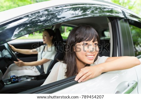 asian parent and daughter in a car #789454207