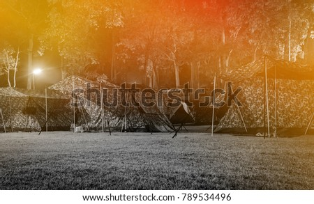 camping tent on grass field at night time with retro filter #789534496