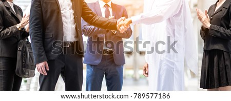 Multi-ethnic and Diverse Business People Shaking Hands. Business deal handshake with Arabic and European ethnic mans. #789577186