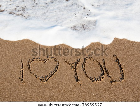 inscription in the sand - i love you