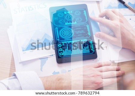 Top view of businessman hands using tablet with business interface placed on office desk with reports and city view. Technology and finance concept. Double exposure  #789632794