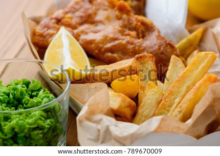 Macro view on green peas, fish and chips. British lunch concept. Easy and tasty way to still your hunger. #789670009