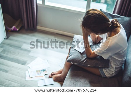 Young women worried about bills Royalty-Free Stock Photo #789678214
