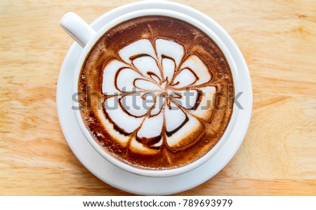 hot coffee mocha latte on wooden table background #789693979
