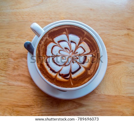 hot coffee mocha latte on wooden table background #789696073