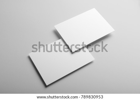 Real photo, business card mockup template, front and back, isolated on light grey background to place your design.