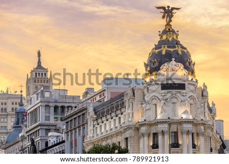 Madrid downtown in gran via main shopping street with traffic light during twilight sunset,Spain. #789921913