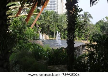 small fountain in a tropical garden #789935026
