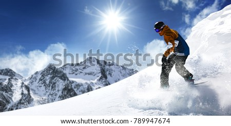 Winter time. Skier and mountains landscape  #789947674