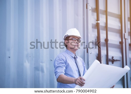 Civil engineer wearing white hard hat holding the blueprint and look forwarding to the success in project #790004902