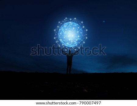 concept global network connection in hands on night sky background / soft focus picture / Blue tone concept