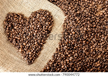 Coffee beans with wood scoop. Coffee beans background. Fresh hot best coffee beans.Coffee heart  #790044772