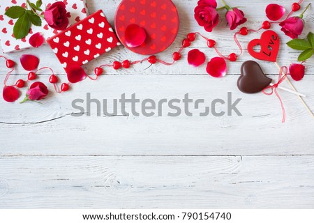Roses and red hearts on a wooden background and gifts in boxes #790154740