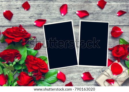 valentines day background. blank photo frames with red rose flowers bouquet and gift box on rustic wooden background. top view. mock up. flat lay