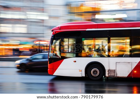 picture of a bus in city traffic in motion blur Royalty-Free Stock Photo #790179976