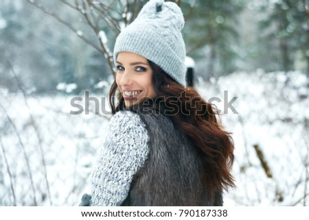 beautiful smiling young woman in wintertime outdoor. Winter concept  #790187338