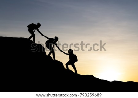 Silhouette of yong woman helping each other hike up a mountain at sunrise background. Business, teamwork, success and help concept. Vintage filter. #790259689