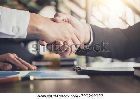 Meeting and greeting concept, Two confident Business handshake and business people after discussing good deal of Trading contract and new projects for both companies, success, partnership, co worker. #790269052