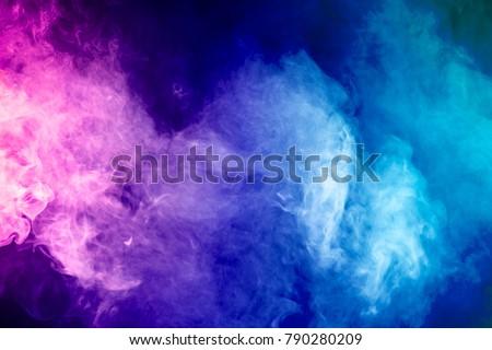 Blue, pink, purple vape smoke on black isolated background Royalty-Free Stock Photo #790280209