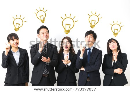 Group of asian business persons coming up with a good idea.