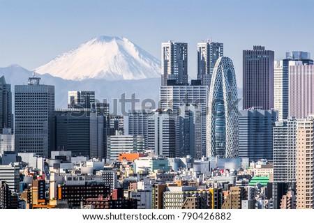 Tokyo Shinjuku building and Mt. Fuji at Behind
