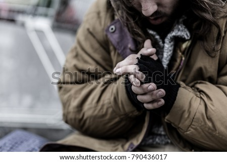 Close-up of dirty hands of beggar. Problems of homeless person in the city concept #790436017