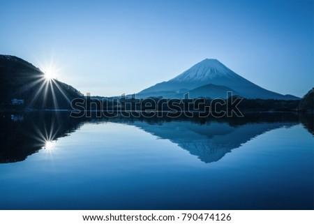 Winter Mountian Fuji and Lake Shoji in morning sunrise. Lake Shoji is the one of the Fuji Five Lakes and located in southern Yamanashi Prefecture near Mount Fuji #790474126