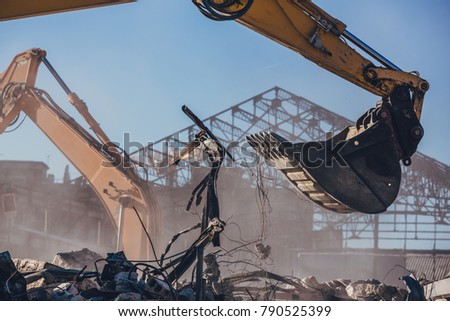 Excavator Working On a Demolition Site Royalty-Free Stock Photo #790525399