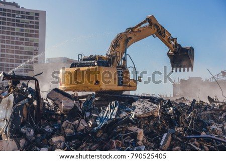 Excavator Working On a Demolition Site Royalty-Free Stock Photo #790525405