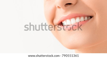 Beautiful smile young woman. White teeth on the master plan. Free space and background to use. Royalty-Free Stock Photo #790551361
