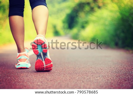 Young fitness female runner legs ready for run on forest trail  #790578685
